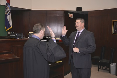 Photo of Lee Bucksath being sworn into office